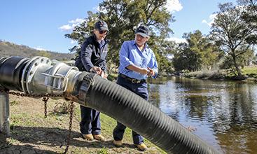 NRAR staff inspecting water pump.